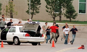 Students flee the 1999 shooting at Columbine high school, where 12 students and one teacher were murdered.