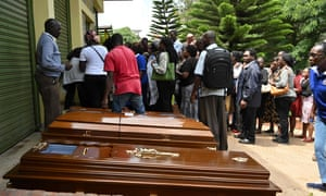 Relatives stand next to empty coffins at the Chiromo mortuary in Nairobi, Kenya, on Wednesday.