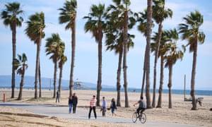 People visit Santa Monica beach in Los Angeles county.