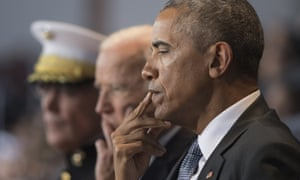 President Obama looks pensive at an Armed Forces dinner in his honour