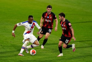 Jordan Ayew of Crystal Palace attempts to go past Bournemouth's Adam Smith and Lewis Cook.