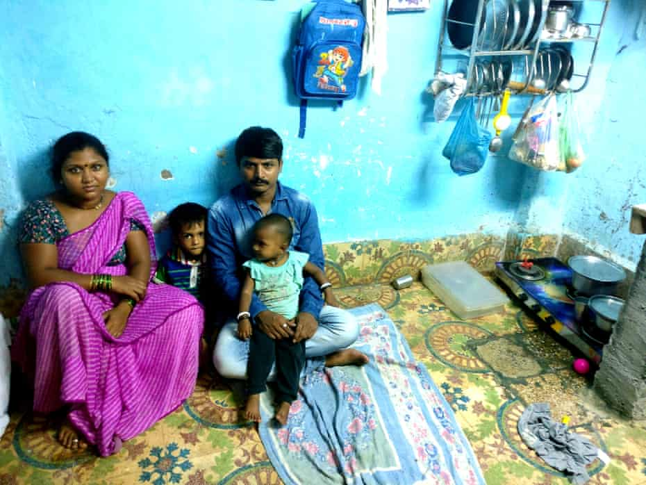 Prakash Shinde with his wife Pooja and their two children. They live on the ground floor of dilapidated Sukh Sadan building