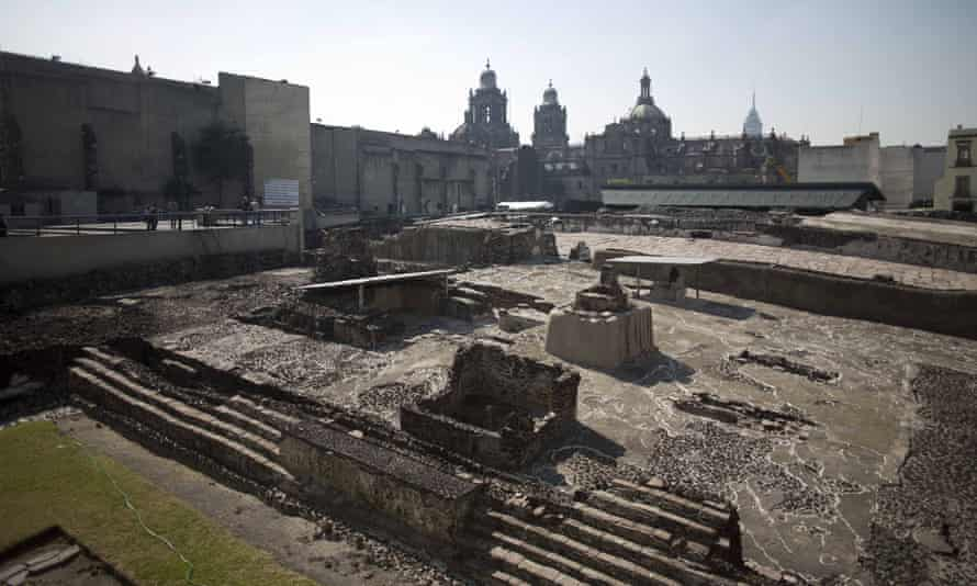 Tourists visit the Templo Mayor an Aztec archaeological site in Mexico City.