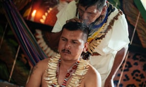 Siona spokesman Mario Erazo Yaiguaje participating in a healing ceremony with elder Pablo Maniguaje. Both men recently appeared before the Inter-American Commission on Human Rights to talk about the armed conflict in their territory-