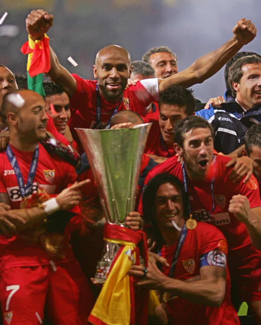 Frédéric Kanouté and his Sevilla teammates celebrate with the UEFA Cup after beating Espanyol on penalties in 2007.