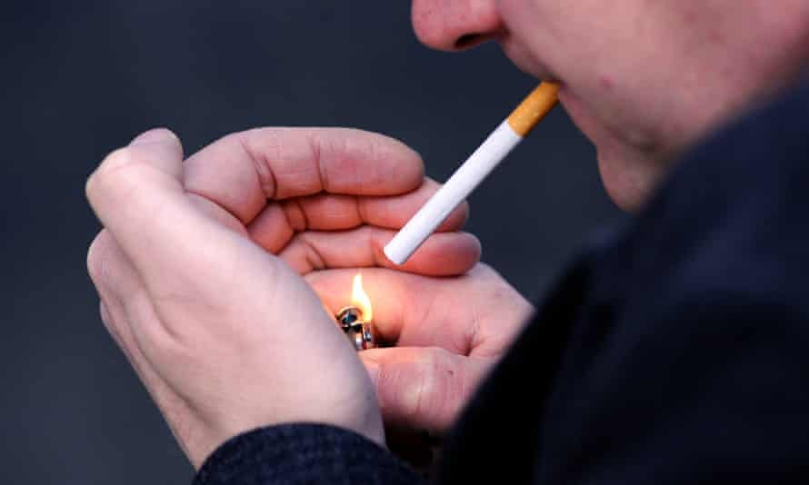 A man lights a cigarette