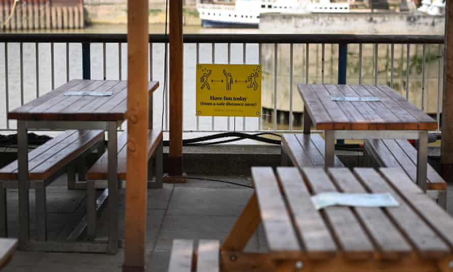 A social distancing sign at an outside restaurant in London.