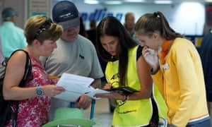 British tourists, clients of Thomas Cook travel group, helped by airport staff at Heraclion airport on Crete.