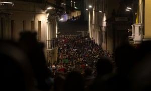 Crowds visit the historical centre of Quito during a light show held to mark the UN's Habitat III conference.
