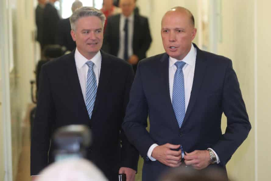 Mathias Cormann (left) and Peter Dutton emerge from the Liberal party room meeting on 24 August 2018, the day Scott Morrison was sworn in as Australia's 30th prime minister.