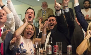 Leave campaigners celebrate as they watch the results of the referendum come in