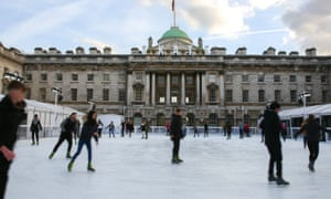 Skaters on the rink at Somerset House on the Strand in London