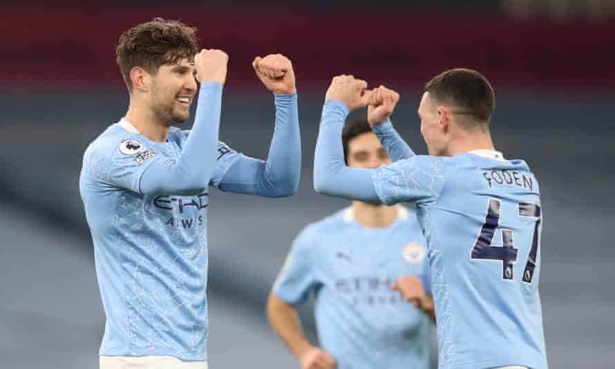 John Stones celebrates his second goal with Phil Foden.