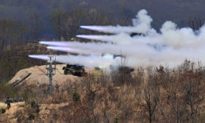 South Korea's multiple rocket launch system fires rockets during joint live firing drill between South Korea and the US in Pocheon. The US has agreed to suspend joint war games with South Korea.