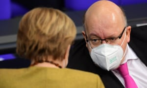 German economy minister Peter Altmaier talks to German chancellor Angela Merkel on Thursday.