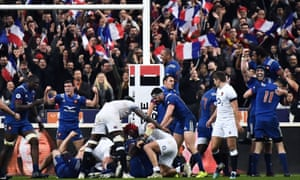 France's players celebrate after the final whistle goes.