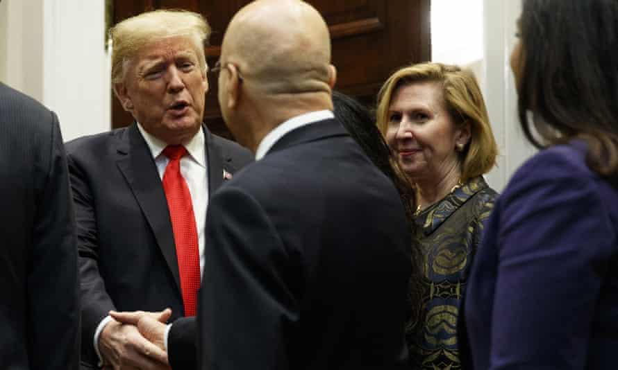 The deputy national security adviser, Mira Ricardel, right, watches as Donald Trump arrives for a Diwali ceremony in the Roosevelt Room of the White House on Tuesday.