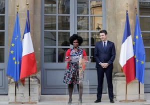 Newly appointed French Junior Minister and Government's spokesperson Sibeth Ndiaye (L) speaks next to her predecessor Benjamin Griveaux during a hand over ceremony at the ministry in Paris on April 1, 2019
