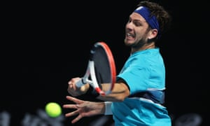 Cameron Norrie fires a forehand to Pierre-Hugues Herbert.