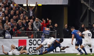 Anthony Watson of England tackles Benjamin Fall of France and is later yellow carded for this incident and a penalty try is awarded to France