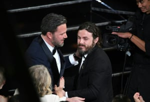 Winner for Best Actor Manchester By The Sea Casey Affleck is embraced by his brother Ben Affleck on stage