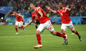 Artem Dzyuba celebrates scoring Russia's third goal in their 3-1 victory against Egypt in Group A.