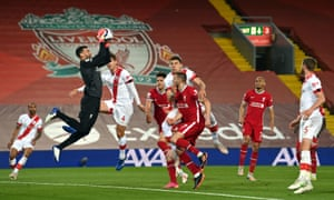 Liverpool goalkeeper Alisson claims a free kick.