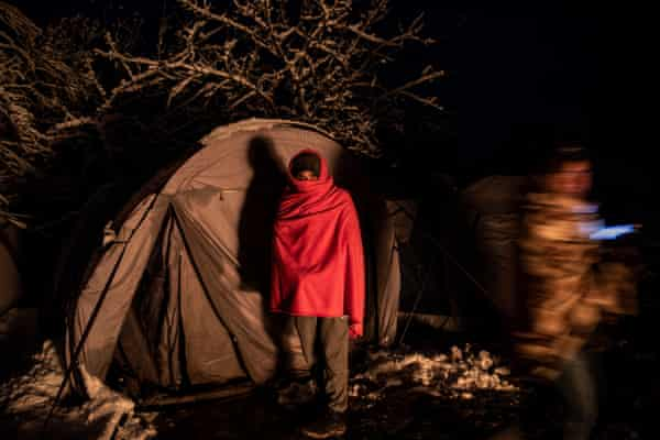 Asmad in front of his tent at the Vucjak migrants camp.