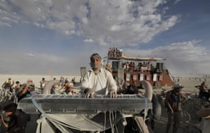 Pianist Murray Hidary plays classical music composed on the fly from an electric piano set up on top of an art car