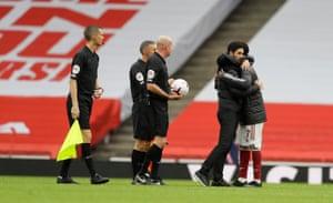Mikel Arteta embraces Bukayo Saka after the match