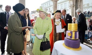 Britain's Queen Elizabeth greets Nadiya Hussain, winner of the Great British Bake Off who baked a cake for her as she walks through Windsor on her 90th Birthday, in Windsor, Britain April 21, 2016. REUTERS/John Stillwell/Pool