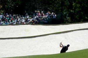 Lee Westwood of England plays his second shot from a bunker on the 5th