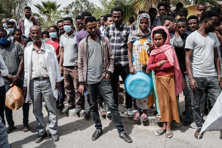 People watch wounded people arriving at the Ayder hospital in Mekele last week after a deadly airstrike on a market