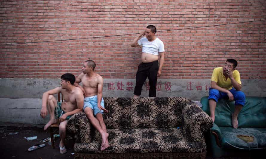 Men in a migrant village on the outskirts of Beijing.