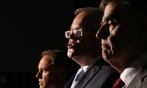 Australian prime minister Scott Morrison, health minister Greg Hunt and chief medical officer Brendan Murphy at a press conference in the Blue Room of Parliament House in Canberra on Thursday.