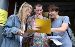 Madeline Ashman, Thomas Wroy and William Sharp after collecting their A-level results at Peter Symonds college in Winchester, Hampshire