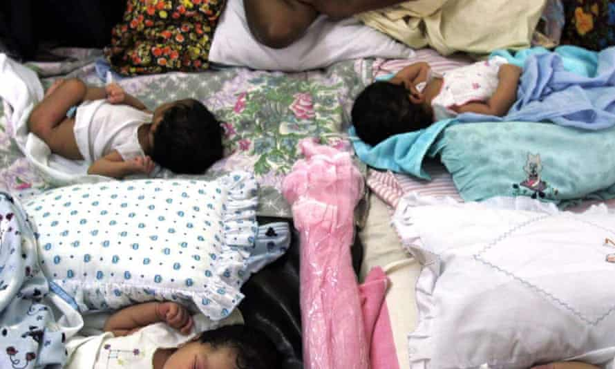 Newborn babies in Sri Lanka share a bed at a crowded central hospital in Galle, south of Colombo