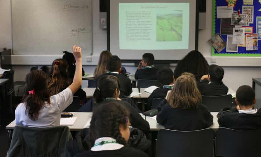Students take part in a geography lesson at a secondary school