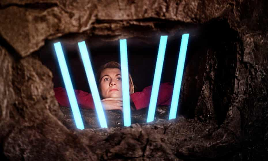 Jodie Whittaker as Doctor Who, imprisoned by 16 years of the show's own continuity.