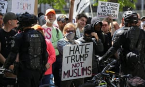 Counter-protesters hold signs outside of an 'anti-sharia rally' in Seattle.