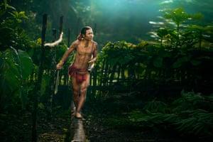 Mentawai tribesman walks through an area where   vegetables are grown