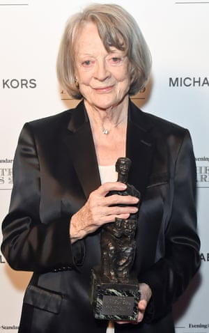 Maggie Smith posing with her award