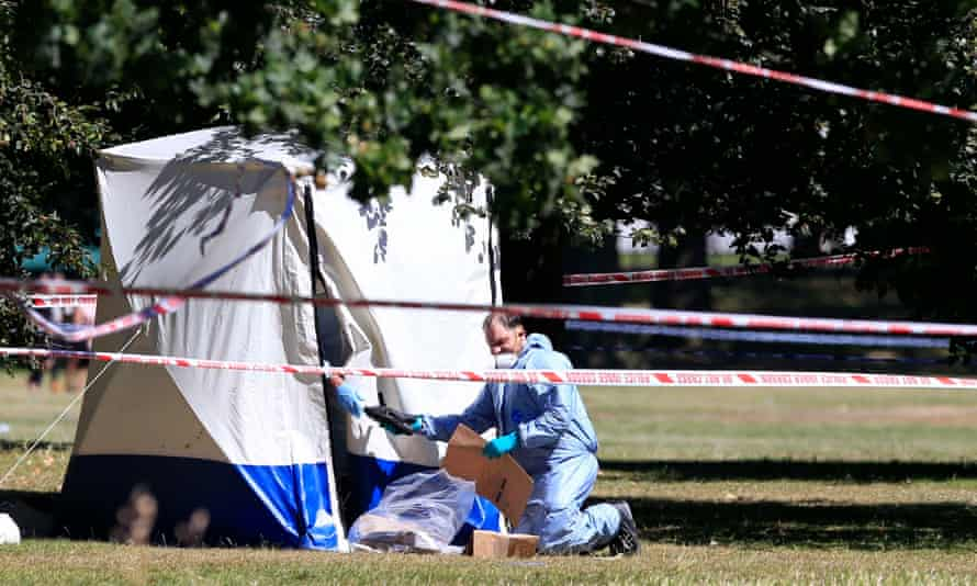 A forensic officer at a crime scene in central London.