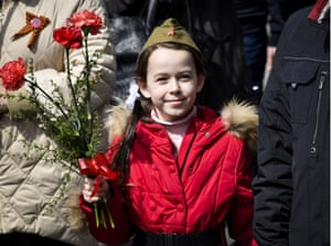 A girl carries flowers during the Immortal Regiment procession