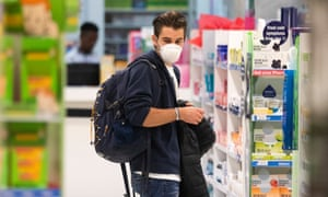A traveler looks in a pharmacy at Cape Town international airport, South Africa.