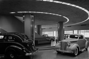 Automobiles at the Chrysler building inside its showroom, 1936