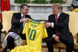 Washington DC, US Brazilian President Jair Bolsonaro presents President Trump with a Brazilian national team soccer jersey