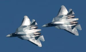 Sukhoi Su-57 jet fighters fly over at an air display event near Moscow in August 2017.