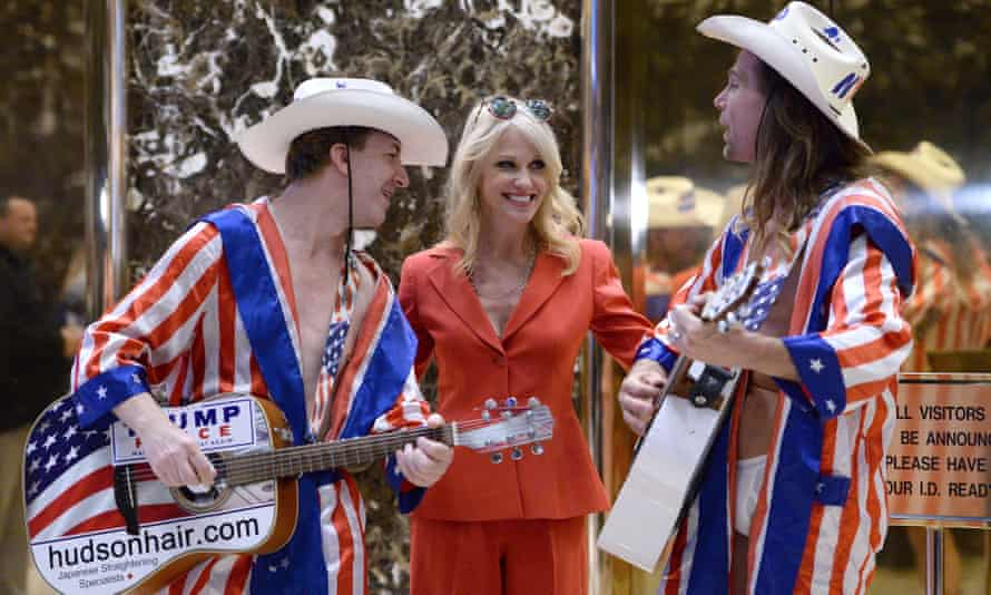 Kellyanne Conway, Trump's campaign manager and strategist, visits the lobby of Trump Tower with performers in the Naked Cowboy mold.