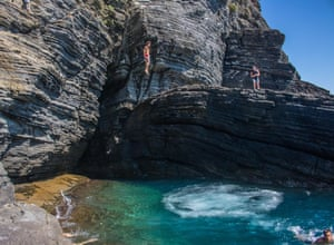 By Eddie Smith. Italian boys try to out dive each other from the cliffs of Vernazza, in Liguria. I sat watching them attempt more and more daring dives. Their showmanship had me captivated for an hour as I sat on the rocks … not quite brave enough to join them.